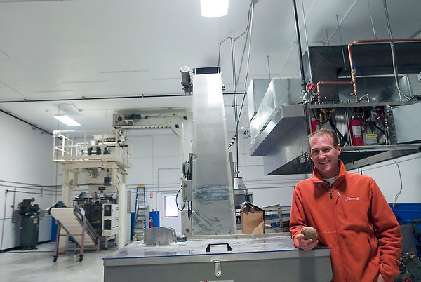 Record-Eagle/Douglas Tesner<br /> Chris Girrbach stands in the new potato chip plant for Great Lakes Potato Chips company.