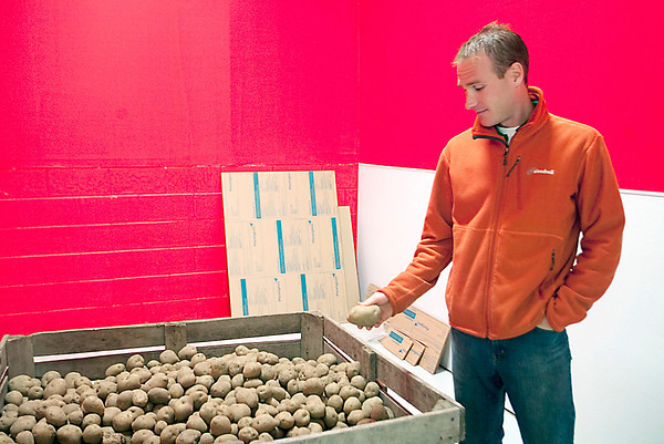 Record-Eagle/Douglas Tesner<br /> Chris Girrbach stands in the new potato chip plant. Great Lakes Potato Chips company has been started by Ed Girrbach and son Chris Girrbach, owners of Pangea's Pizza. They're starting with three potato chip flavors made from Michigan potatoes.