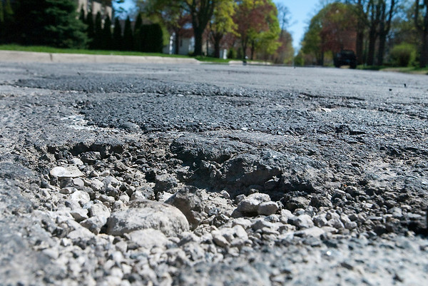 Record-Eagle/Douglas Tesner<br /> Several potholes exist along Elmwood Avenue in Traverse City.