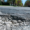 Record-Eagle/Douglas Tesner<br /> Several potholes exist along Elmwood Avenue in Traverse City.