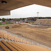 Record-Eagle/Jan-Michael Stump<br /> Work progresses on Thirlby Field Thursday, where artificial turf is replacing the grass in an approximately $825,000 project. Local brothers Don and Gerry Oleson are funding the project, which includes turf installation and landscaping projects around the field. Traverse City Central, Traverse City St. Francis and Traverse City West teams currently use the field.