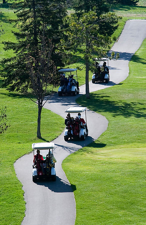 "Record-Eagle/Douglas Tesner<br /> Golf carts head down the cart path on ""The Bear"" course at Grand Traverse Resort & Spa. The golfers were maing their way toward the starting tees."
