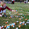 Record-Eagle/Douglas Tesner<br /> Wills Henderson, 5, helps spread some of the more than 20,000 Easter Eggs at the 25th Annual Traverse City Easter Egg Hunt at the Grand Traverse Civic Center on Saturday.