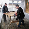 Record-Eagle/Alex Piazza<br /> Chris Liss and Billy Wood board up a window at Lifer Skateboard Shop on Front Street in Traverse City. Police said a skateboard and three longboards were stolen fronm the business Tuesday morning.