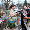 Record-Eagle/Douglas Tesner<br /> Angie Liquia and her daughter, Emily, spend make a purchase from Kim Hooker, right, on Friday during a yard sale at the home of Hooker and Kevin Grave on Wadsworth Street in Traverse City. The weather was perfect for the sale, Grave said.