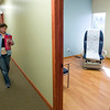Record-Eagle/Jan-Michael Stump<br /> Patrice McDonald, of Custom Draperies by Patrice, carries a ladder to install blinds in the Grand Traverse Surgery in the new medical office building at the corner of West Front Street and Division Street in Traverse City.