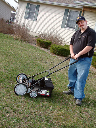Record-Eagle/Lisa Perkins<br /> Bill Schramm uses a hand-powered reel lawn mower to service the clients of his eco-friendly business, Clean Cuts.