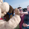 Record-Eagle/Douglas Tesner<br /> Landon Sweet, 1, held by his mother, Amanda Sweet, gives a high-five to Biscuit, the mascot for Bob Evans.