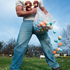Record-Eagle/Douglas Tesner<br /> He's not the Easter Bunny, but Zack Beeler, a strong safety for the Traverse City Timber Wolves, helps distribute eggs on the field for the event.