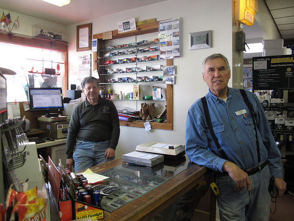 """Record-Eagle/Bill O'Brien<br /> Hardware store owner Dave Engels, left, and employee Art Lezotte wonder how a proposed partnership between Munson Healthcare and Spectrum Health will impact operations at Paul Oliver Memorial Hospital in Frankfort. """"It's handy to have,"""" Lezotte said of Paul Oliver. """"I'd hate to have to drive to Traverse to go to the hospital."""""""