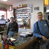 "Record-Eagle/Bill O'Brien<br /> Hardware store owner Dave Engels, left, and employee Art Lezotte wonder how a proposed partnership between Munson Healthcare and Spectrum Health will impact operations at Paul Oliver Memorial Hospital in Frankfort. ""It's handy to have,"" Lezotte said of Paul Oliver. ""I'd hate to have to drive to Traverse to go to the hospital."""