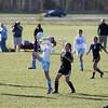 Record-Eagle/Jan-Michael Stump<br /> TC Liberty's Suzanne Britten (15) traps the ball in front of Glen Lake's Clare Slack.