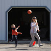 Record-Eagle/Jan-Michael Stump<br /> Alex Reynolds, 6, shoots hoops outside his Westmore Drive home with his grandmother, Patti Reynolds, and sister, Pearl Reynolds, 3, (not pictured).
