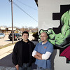Record-Eagle/Keith King<br /> Doug Mead, left, and Mike Akerley, co-owners of Top Comics, stand outside the business Wednesday as traffic travels along Eighth Street.