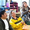 Record-Eagle/Jan-Michael Stump<br /> Cristiano Paniagua, left, and Maria Calderon, center, laugh as their niece, Cruz Paniagua, 17, explains a misinterpreted translation during an English as a second language class at Peninsula Township Library.