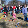 Record-Eagle/Douglas Tesner<br /> of children, with some help from adults, hunt for Easter eggs on Saturday at the Grand Traverse Civic Center. Billed as northwest Michigan's largest Easter egg hunt, hundreds of children searched for more than 16,000 Easter eggs filled with an assortment of candy.