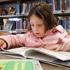 Record-Eagle/Douglas Tesner<br /> Alexa Lammers, 7, a student at Traverse Heights Elementary School, reads a book at the Traverse Area District Library.  The Library is celebrating its 10th anniversary at the Woodmere Ave. location this year.