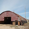 Record-Eagle/Jan-Michael Stump<br /> A quonset hut on Beitner Street that was the scene of the June 2011 murder of teenager Carly Lewis is beginning to be demolished