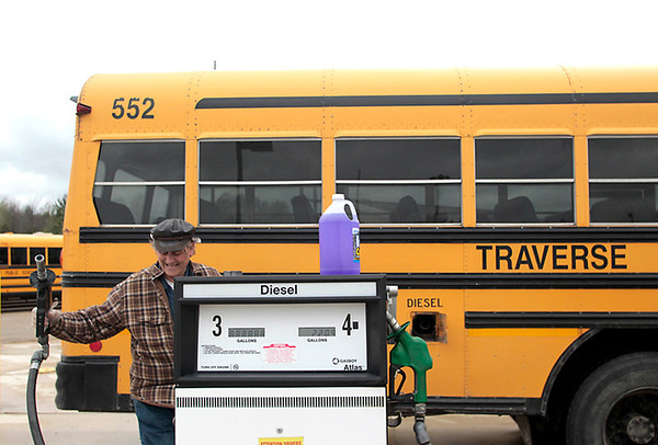 Record-Eagle/Jan-Michael Stump<br /> TCAPS bus driver Randy Martin fills his fuel tank after he dropped off students after school on Monday.