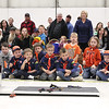 Record-Eagle/Keith King<br /> Spectators and members of the Tiger Cub Den look on Saturday during the Boy Scouts of America Bay Trails District Pinewood Derby Finals at the United States Coast Guard Air Station Traverse City hangar.
