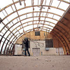 Record-Eagle/Jan-Michael Stump<br /> Ryan Fraser works with a crew from RCP Recycle as they deconstruct the quonset hut on Beitner Street that was the scene of the June 2011 murder of teenager Carly Lewis.