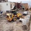 Record-Eagle/Keith King<br /> Construction continues Wednesday in the alley north of East Front Street's 200 block. The work is part of a city project to repair and improve the alley along the Boardman River. City officials said the alley currently is closed to most traffic. Work is expected to finish before Memorial Day.