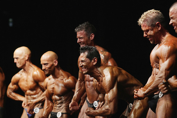 Record-Eagle/Keith King<br /> Men strike a muscular pose during the prejudging portion of the 32nd annual Grand Traverse Bodybuilding and Figure Championship at the Leelanau Sands Showroom on Saturday.