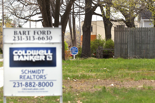 Record-Eagle/Keith King<br /> Real estate signs are positioned near houses Thursday, April 19, 2012 along Barlow Street in Traverse City.