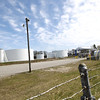 Record-Eagle/Keith King<br /> Tanks from the Marathon Petroleum fuel depot are visible from along the TART Trail in Greilickville.