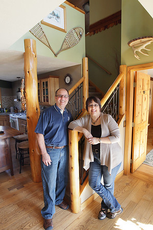 Record-Eagle/Keith King<br /> Victor and Nancy Lisabeth, of Bingham Township, stand in their home.
