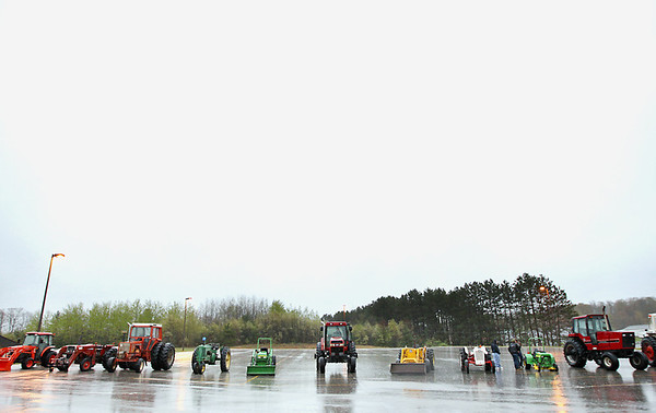 Record-Eagle/Keith King<br /> Tractors are parked during Tractor Day at the Kingsley High School parking lot.