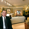 Record-Eagle/Douglas Tesner<br /> Golden-Fowler Home Furnishings owner Mike Mahn shows off his new furniture display area. The expanded showroom translates to better deals for shoppers as area businesses get more creative to attract consumers in trying economic times.