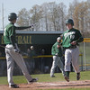 Record-Eagle/Keith King<br /> Traverse City West's Matt Beem (19) is congratulated by teammate Joe Caraccio, left, as Beem scores a run against Manistee Monday.
