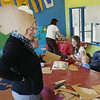 Record-Eagle/Keith King<br /> Gailia Masselink, of Traverse City, tries on her cardboard fish headgear piece on Monday during a fish mask and headgear workshop at the Great Lakes Children's Museum. The workshop will be followed by other events throughout the week that will lead up to the 23rd annual Earth Day Parade scheduled for Saturday, April 28, 2012. The lineup for the parade is scheduled for noon on Saturday at Central Grade School with the parade to begin at 1 p.m.