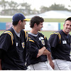 Record-Eagle/Jan-Michael Stump<br /> Traverse City Beach Bums catcher Jon Hurst, right, talks with teammates Brian Heere, center and Travis Higgs, left, during the team's media day Thursday at Wuerfel Park.