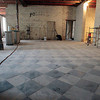 Record-Eagle/Jan-Michael Stump<br /> The original tile floor is being preserved for future restaurant space in the kitchen area by the chapel in the Village at Grand Traverse Commons.