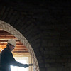 Record-Eagle/Jan-Michael Stump<br /> Eric Freudigman, of MAM Contracting, tuck points brick in the chapel in the Village at Grand Traverse Commons.