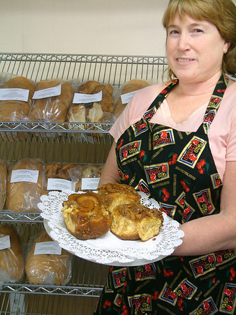 Record-Eagle/Marta Hepler Drahos<br /> Tina Baker, of Chimoski Bakery in Suttons Bay, holds some of her pecan rolls topped with a special sweet glaze.