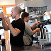 Record-Eagle/Jan-Michael Stump<br /> Baristas Chuck Korson, left, and Erith Welch make coffee drinks for customers Wednesday at Morsels, which moved from its old location at the intersection of East Front and Cass Streets to 321 E.Front St. between Boardman and Park Streets.