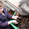 Record-Eagle/Douglas Tesner<br /> Margaret Muench Learner checks on the small compost bin she keeps in her bedroom.