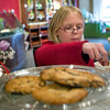 """Record-Eagle/Jan-Michael Stump<br /> """"It's better than my mom's,"""" said Abby Caldwell, 9, of the cookies and milk she had with her mother Pam Caldwell and sister Emma, 12, in Jacques Torres Chocolate shop on Front Street in downtown Traverse City."""