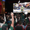 Record-Eagle/Douglas Tesner<br /> Michigan State fans cheer after the Spartans scored their first point — and took their first and last lead — during the NCAA National Championship game. Right, Michigan State's Korie Lucious sits on the bench during the second half of game.