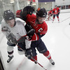 Record-Eagle/Keith King<br /> The Traverse City North Stars' Chris Waterstreet, left, and the Kalamazoo Junior Wings' Chris Leone battle for control of the puck Friday during Game 3 of their NAHL playoff series.