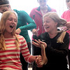Record-Eagle/Jan-Michael Stump<br /> Sara Laisure, 18, left, and Anna Krueger, 17, react as their hair gets cut during Thursday's Hair for Hope event at Traverse City Central High School.