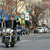 Record-Eagle/Keith King<br /> A motorcyclist without a helmet travels Friday on East Front Street in downtown Traverse City. The use of a helmet has just become optional for many motorcyclists in Michigan.