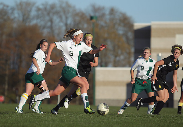Record-Eagle/Keith King<br /> TC West's Mikaela Ray heads down the field as TC Central's Anna Krueger defends.