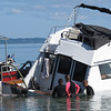 Record-Eagle/Art Bukowski<br /> A 30-foot Baha Cruiser was among two boats that sunk off West End Beach in Traverse City during strong winds Saturday. Several others washed up on shore.