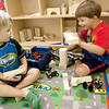 Record-Eagle/Douglas Tesner<br /> Bryce Gilroy, 5, and Isaac Roehling, 3, work on their building skills at the YMCA summer camp program.