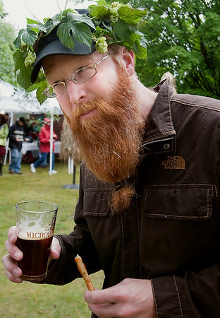 Record-Eagle/Douglas Tesner<br /> Nels Veliquette, of Traverse City, wears some hops on his head as he samples beer at the event. Veliquette said he grows the hops in his backyard.