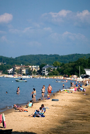 Record-Eagle file photo/Jan-Michael Stump<br /> Swimmers and loungers line the shore at Traverse City State Park beach.